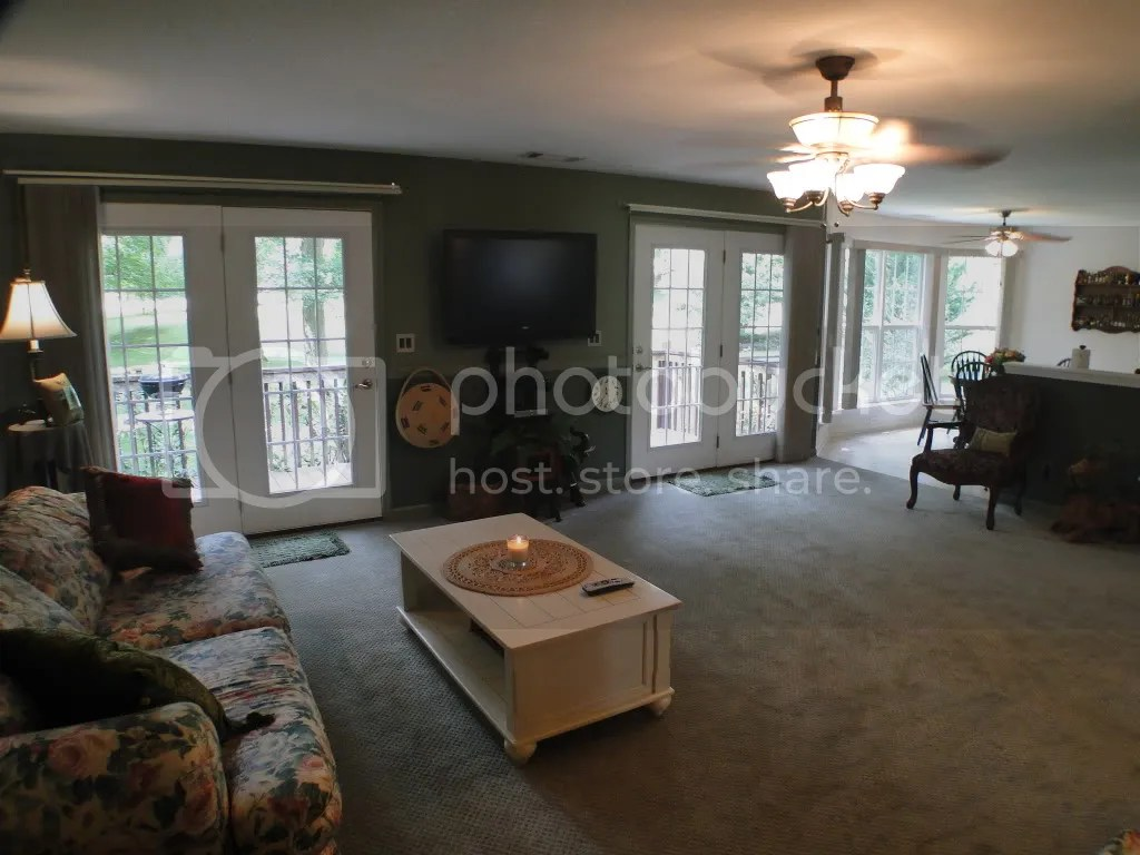 The large living room has two sets of french doors opening to the deck, Macon County Homes for Sale