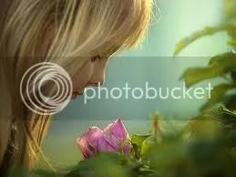 girl sniffing flower