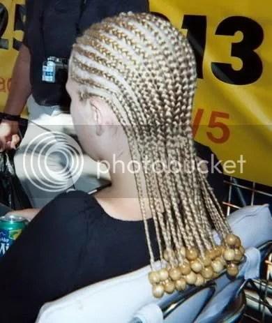 Image of decorated blonde cornrow.