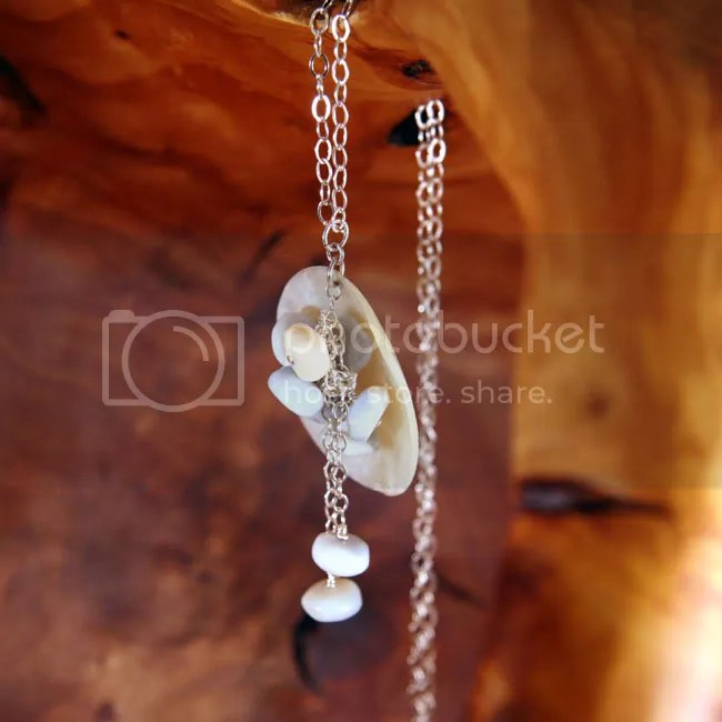 Blue and cream opal buttons against mother-of-pearl: necklace