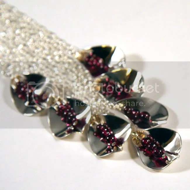 handcrafted sterling silver teardrop petal with garnets