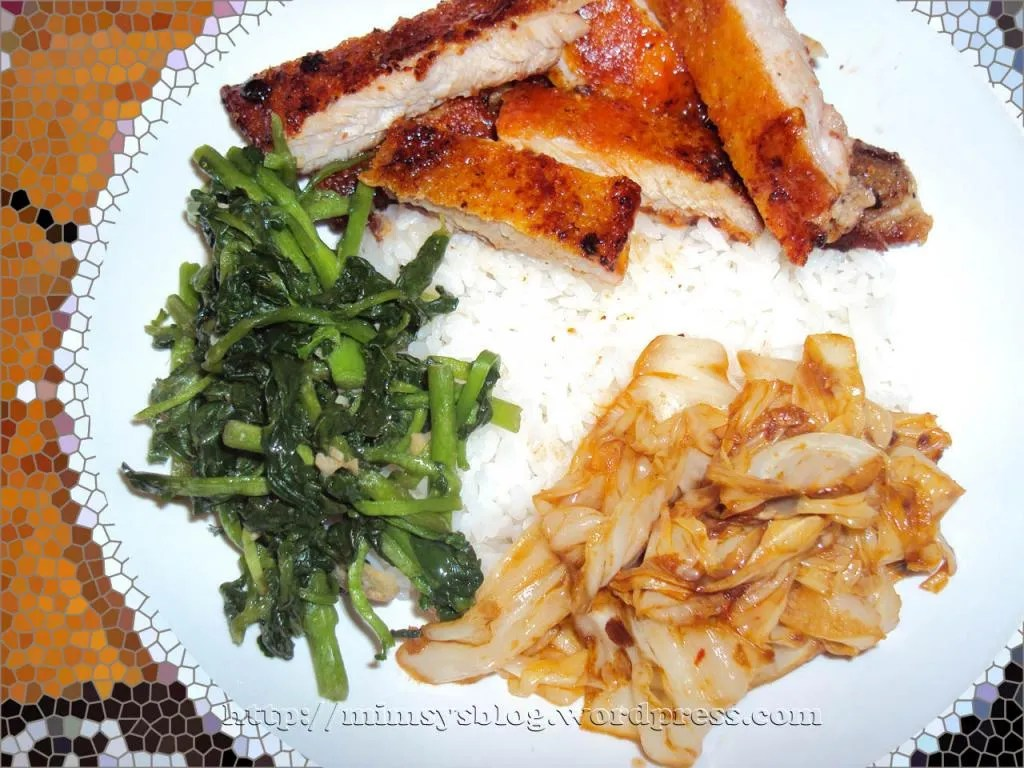 Pan-roasted crispy chicken with white rice, sauteed water spinach with garlic, and stir fried cabbage with Chinese chili sauce.