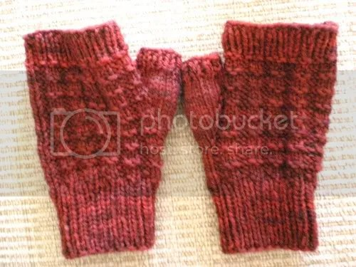 red knitted handwarmers