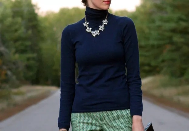 navy turtleneck and green print pants