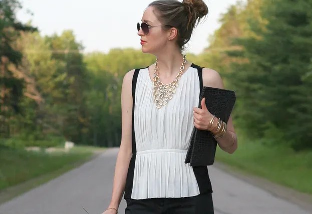 gold bib necklace and black and white outfit