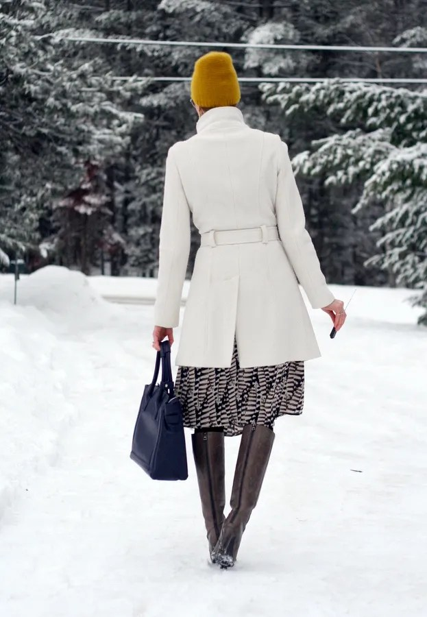winter look wool coat over printed dress
