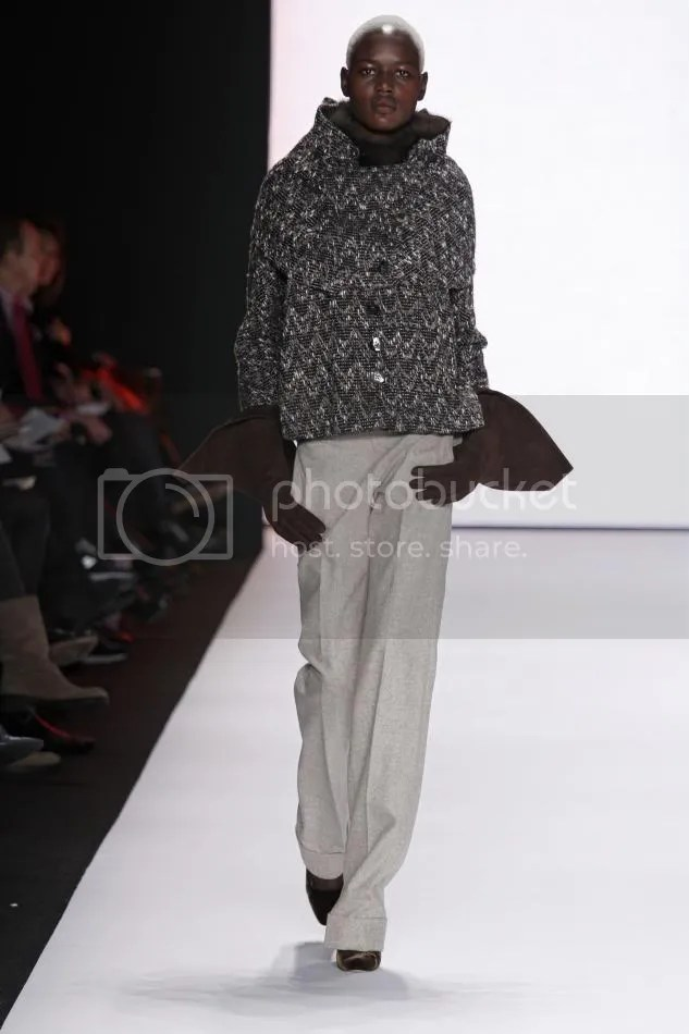 16. Ajak: Cocoa herringbone tweed caplet jacket, clay wool trouser, bargazine sable knit scarf, cocoa suede gloves