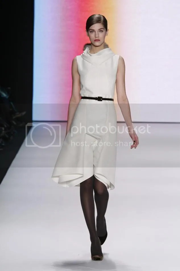 19. Sam: Bone silk and wool organdy dress and black velvet belt.