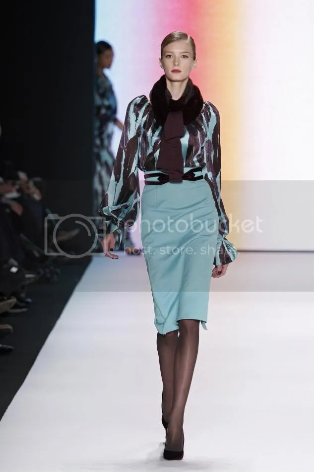 29. Sigrid: Turquoise feather print silk crêpe and wool double face dress, amethyst mink knit scarf, amethyst velvet belt.