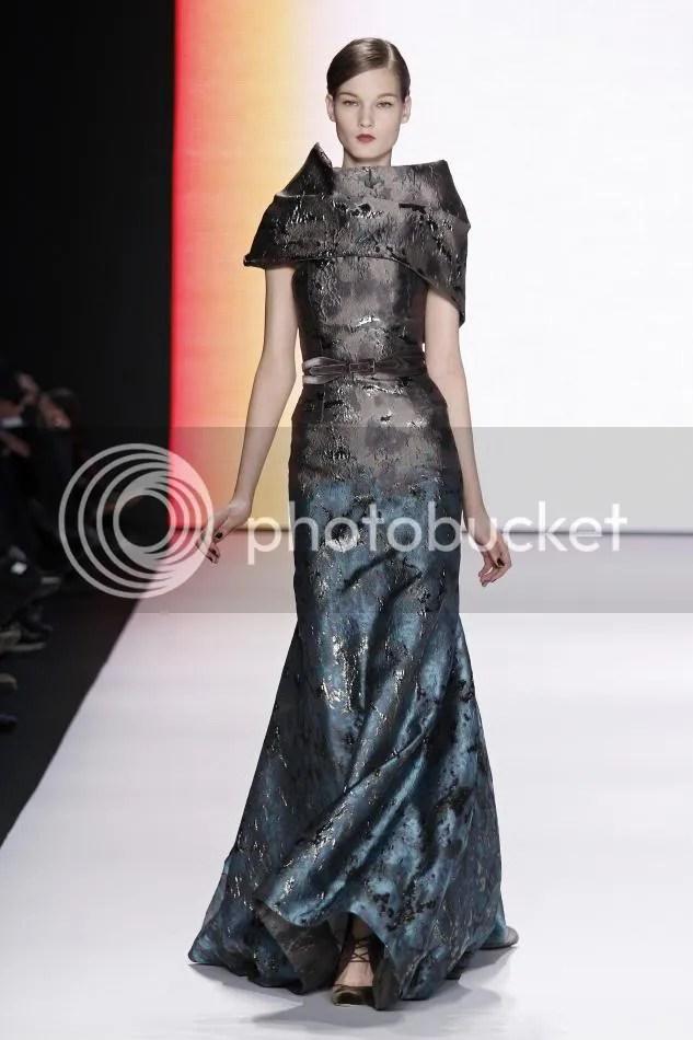 34. Kirsi: Turquoise and dark gray jacquard gown, dark gray velvet belt.