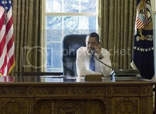 The first photo of President Obama in the Oval Office...