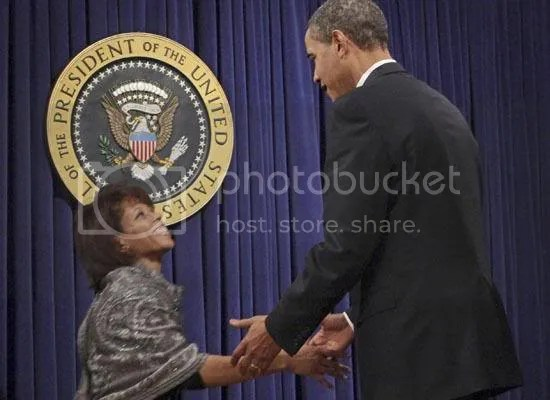 Obama greets Melody Barnes, Director of the White House Domestic Policy Council...