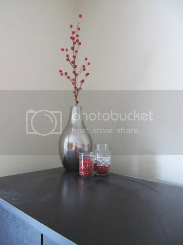 berry pick in silver vase
