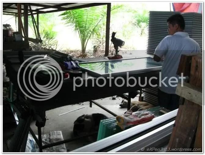 Worker assembling glass pane