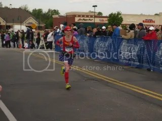 Me sprinting to the finish line at the Geist Half Marathon - Fishers, Indiana