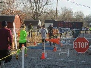 Me crossing the finish line of the Fast Freddie Five Mile Foot Feast - New Albany, IN