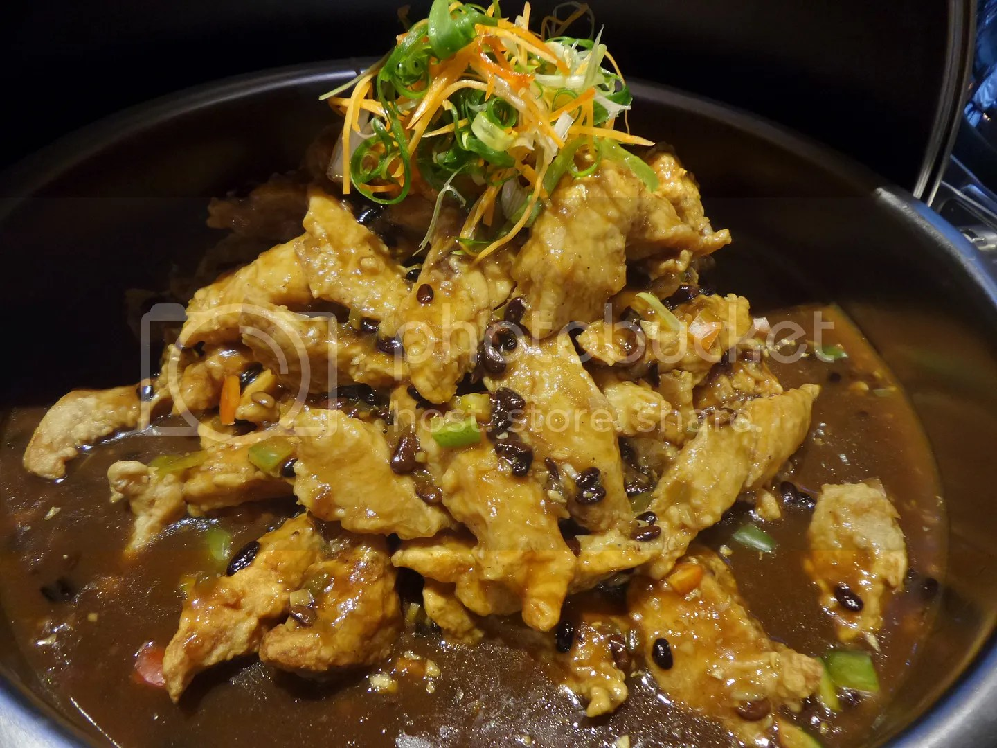 Parrotfish fillet with ginger tausi sauce.