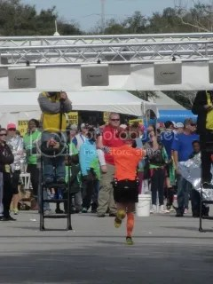 Me crossing the finish line of the Charleston Marathon - Charleston, South Carolina