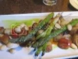 Kalapawai Café's House-made gluten free potato gnocchi w/ grilled asparagus, roasted mushroom & tomato, ver'jus & sauce romesco
