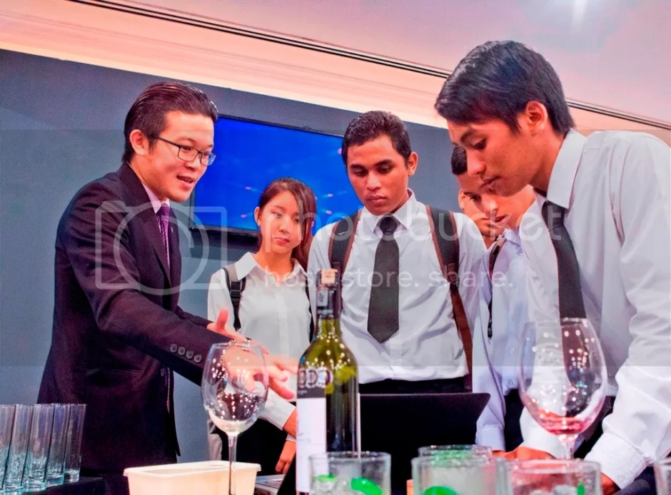 photo Photo 2 - Sommelier Kevin Yee giving briefing to college student_zps8uqagjcr.jpg
