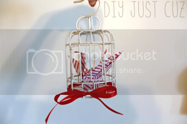Origami paper cranes are beautiful artistic sculptures and paired with a bird cage make for a fascinating and unique paper crane Christmas ornament. @diyjustcuz