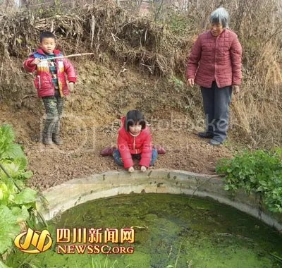 Xin Yin and Yue Long at the pond