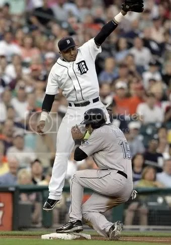 The now-DLed Carlos Guillen and Alex Rios, um, having a moment. How could I NOT use this picture?