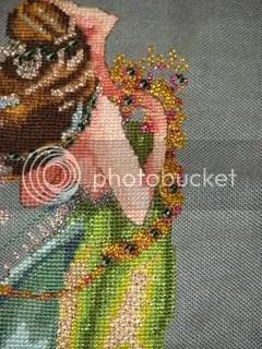 closeup of face and beads