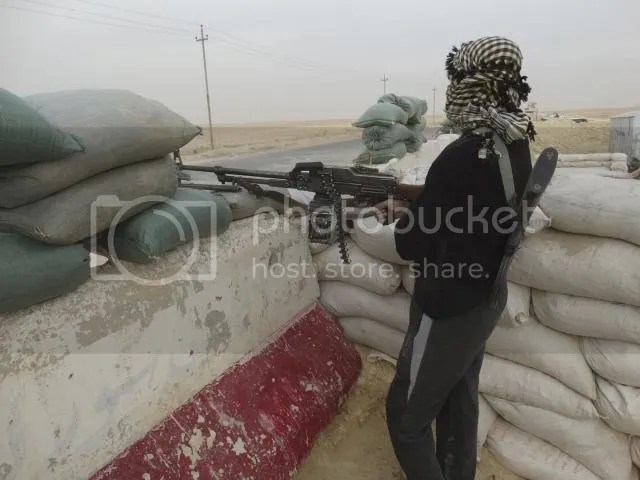 A tribal fighter takes up a position during an intensive security deployment against Islamic State militants in Haditha November 14, 2014.
