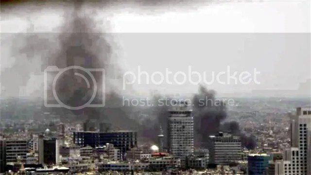 Smoke rises from Damascus military headquarters hit by two explosions