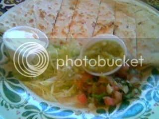 Chicken quesidilla w/ sour cream, salsa & guacamole