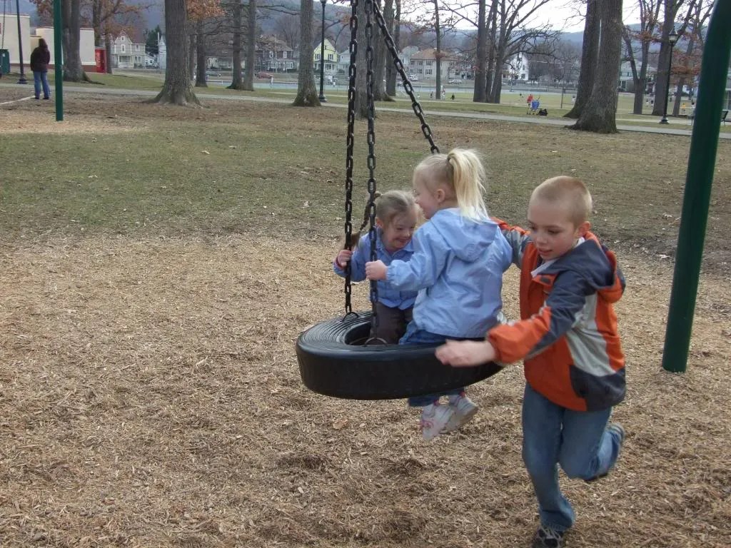You gotta love a cousin who'll spin the kids on the tire.