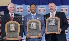 Pat Gillick, Roberto Alomar and Bert Blyleven pose with their plaques during the Baseball Hall of Fame induction ceremony Sunday in Cooperstown. Image source Los Angeles Times, copyright © 2011 Jim McIsaac / Getty Images)
