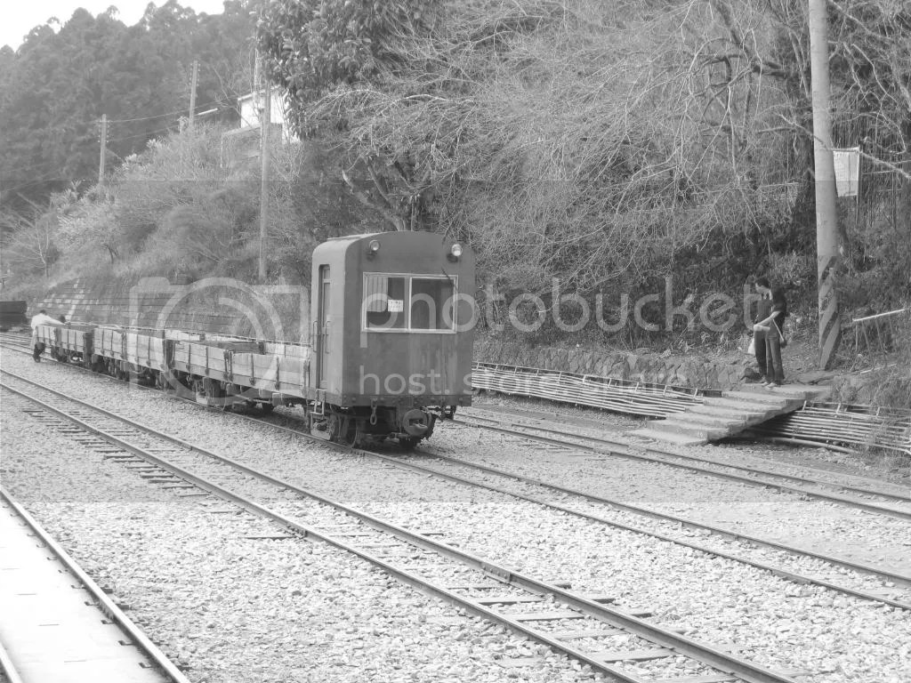 Some display train on the tracks, B/W style.