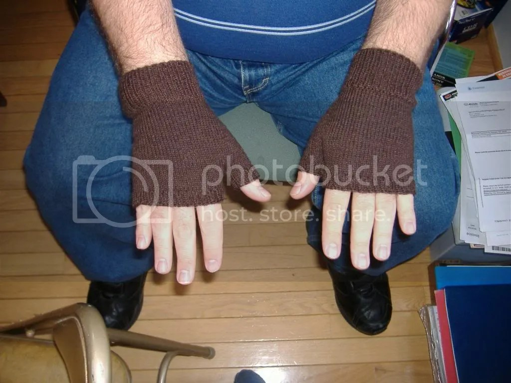 mitts being worn, palm down