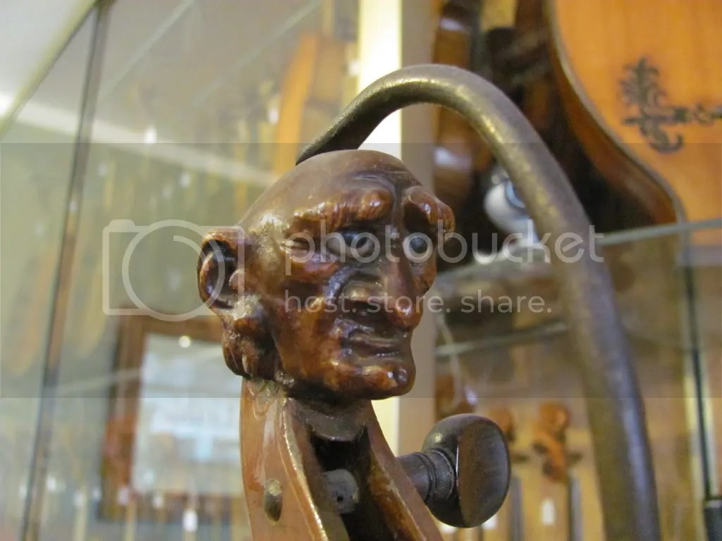 A wooden old man's head