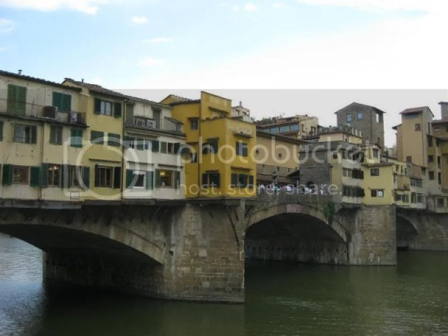 The Ponte Vecchio is a Medieval stone closed-spandrel segmental arch bridge over the Arno River, in Florence, Italy, noted for still having shops built along it, as was once common.During World War II, the Ponte Vecchio was not destroyed by Germans photo 295302_10151093356786209_2128522176_n.jpg