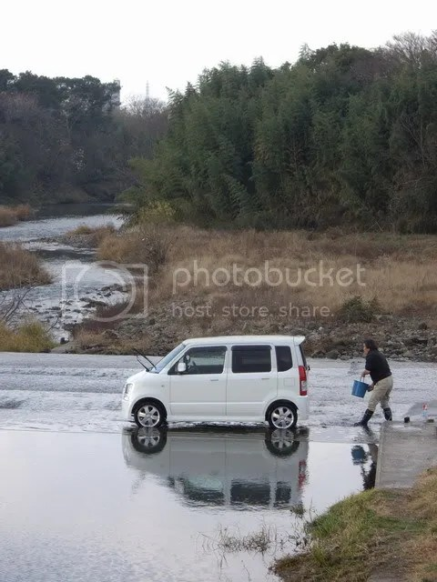 Man washing car in river