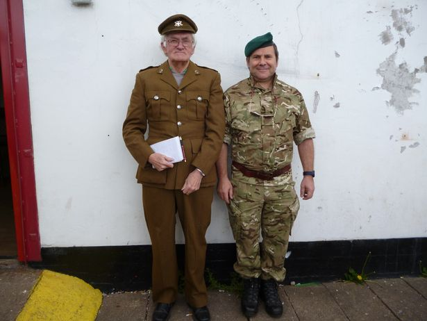 Bill Shaw, notebook in hand, with Andy Roper at the club's Great War commemoration event in 2014