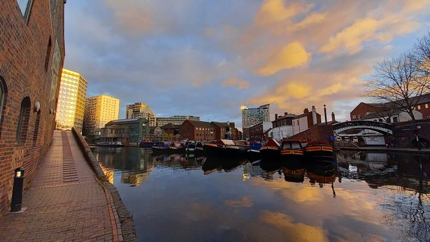 Yards from Broad Street, two of the new Arena Central buildings on the left reflect December's late afternoon golden sunshine back across Gas Street basin, while the sun also bounces off the top left hand corner of city-born architect Ken Shuttleworth's The Cube (2010) in the distance