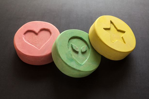 Children as young as 10 have been treated for ecstasy poisoning in Wirral, according to reports (pictured: stock image of ecstasy pills)