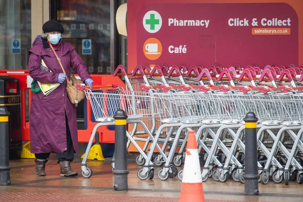 A customer wearing a face mask outside a Sainsbury's store