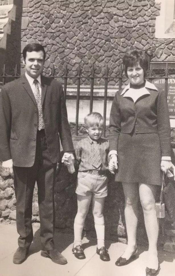 Michael Johnson with his parents David and Brenda Johnson