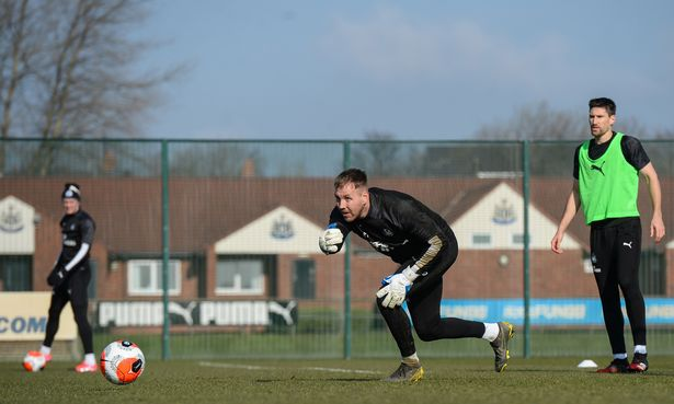 Goalkeeper Rob Elliot throws the ball into play
