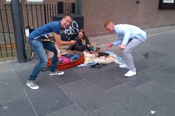Image result for laughing at homeless people