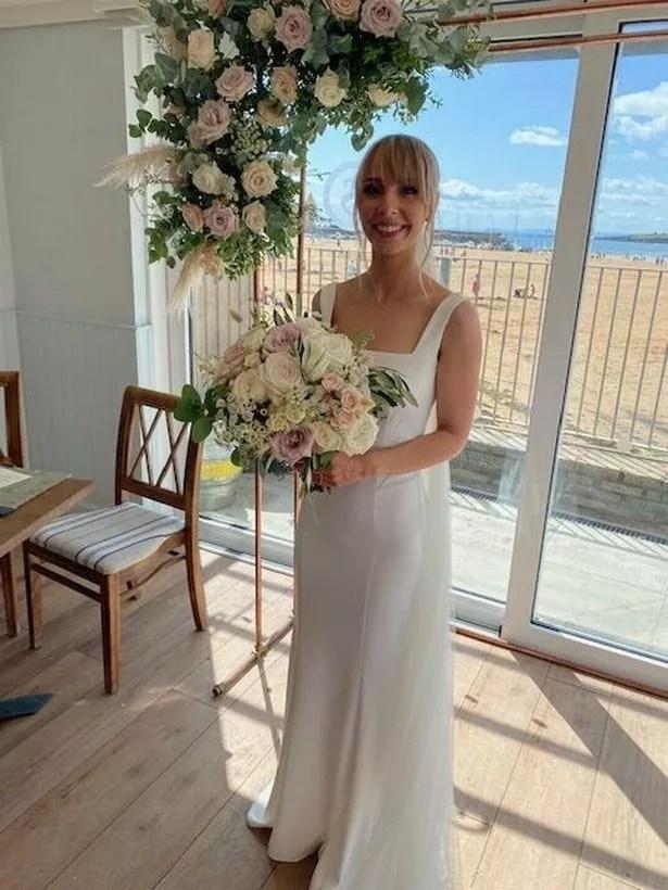 Part of Netta's unique wedding dress was sewn into the hem of her granddaughter-in-law Rachel's wedding dress