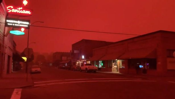 The skies turned blood-red at around noon as the wildfires erupted from the nearby Santiam Canyon