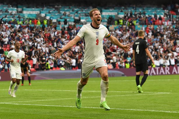 England's forward Harry Kane celebrates after scoring the second goal during the UEFA EURO 2020 round of 16 football match between England and Germany at Wembley Stadium in London on June 29, 2021.