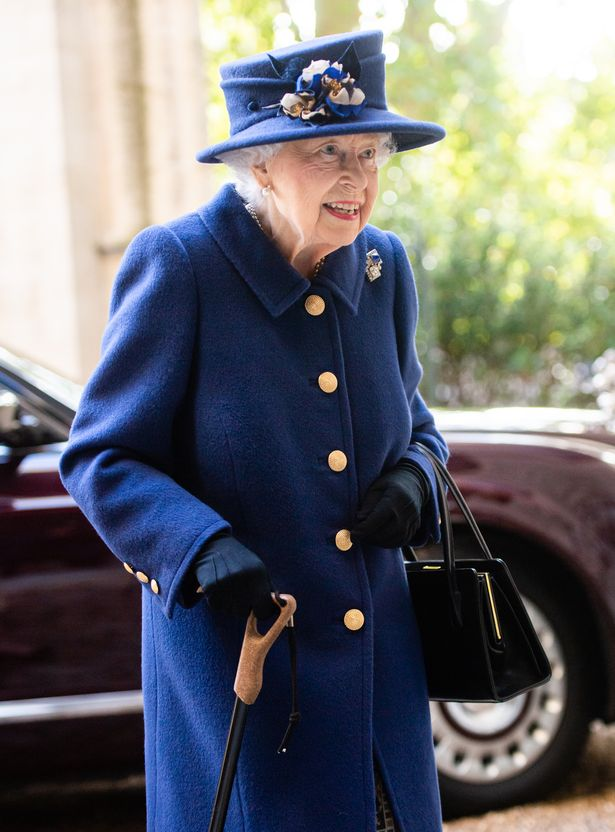 The Queen was seen using a walking stick in public for the first time in 17 years yesterday