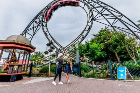 Emma and Shane pictured in front of Revolution ride at Blackpool Pleasure Beach